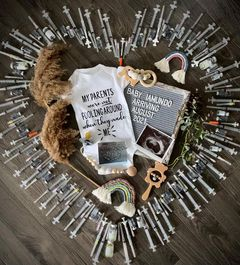 IVF pregnancy announcement with needles in a heart shape