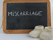 What are the signs of a miscarriage?